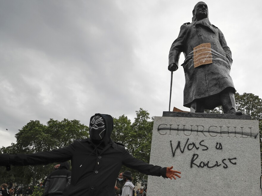 Protesters gather around the Winston Churchill statue in Parliament Square during a Black Lives Matter rally on Sunday in London.