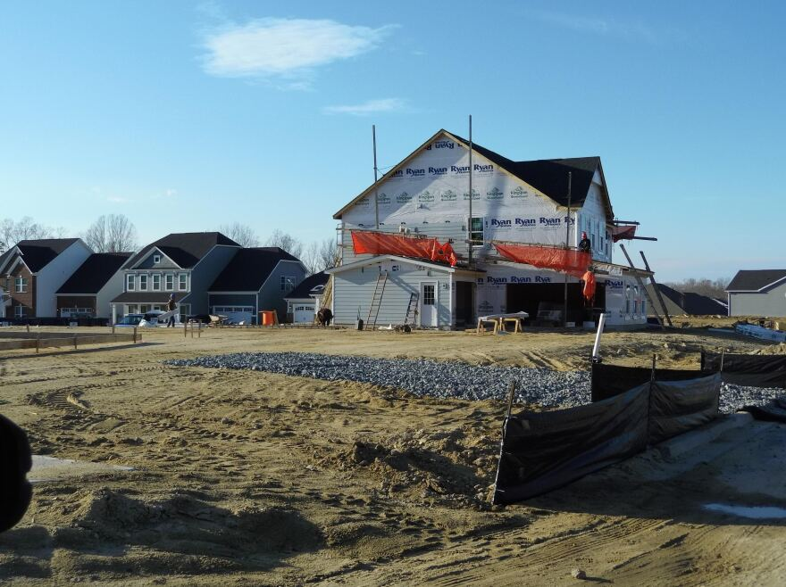 Homes costing $400,000 are seen under construction earlier this year in Huntersville.