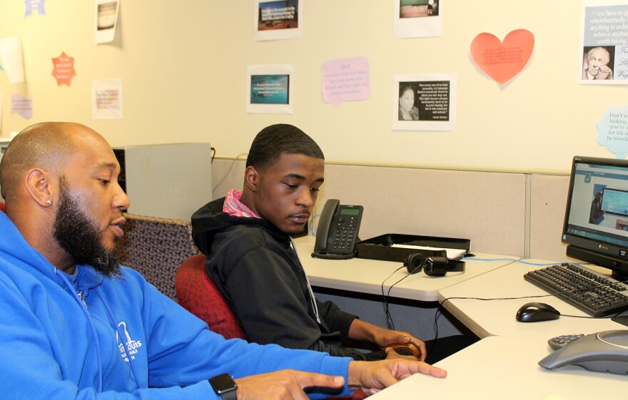 St. Louis Public Schools curriculum instructor Sylvester McClain talks to Workforce High School student Cedric Deshay on Thursday, March 2, 2017.
