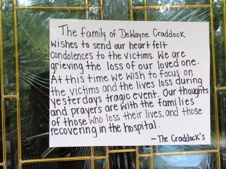 A note attached to the door of the home of one of the shooter's family members extends condolences to the victims of the Virginia Beach shooting.