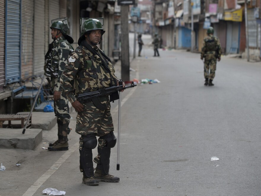 Indian paramilitary soldiers patrol during curfew in Srinagar on Aug. 6.