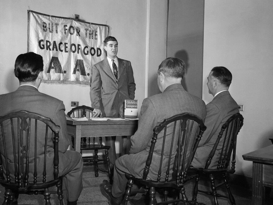 A 1950s depiction of an Alcoholics Anonymous meeting.