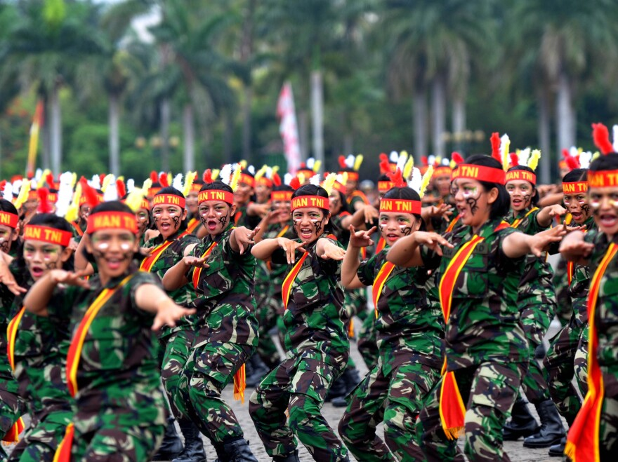 """Female soldiers perform martial arts at a ceremony in Jakarta. Women in Indonesia must undergo an invasive """"virginity test"""" to join the military."""