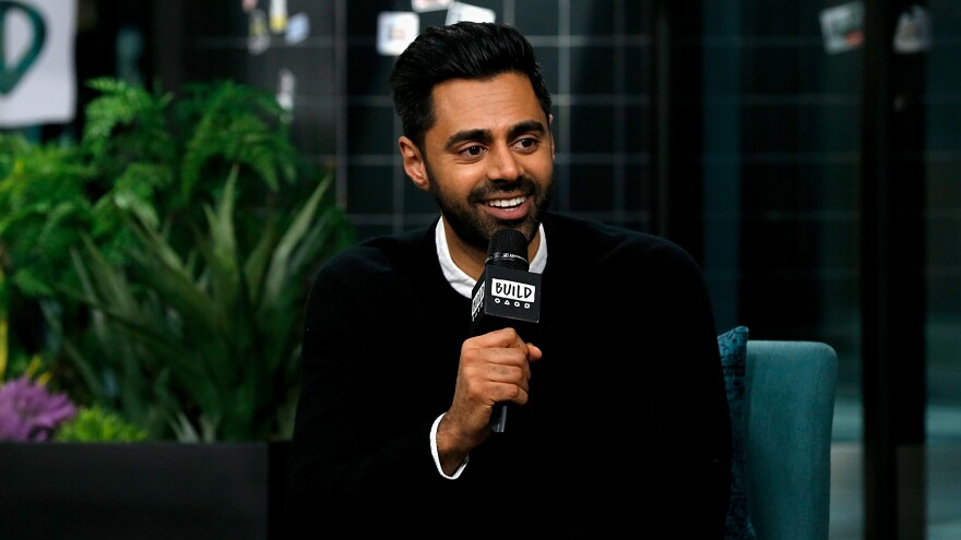 Hasan Minhaj discusses his show <em>Patriot Act</em> at Build Studio on Dec. 2, 2019. Minhaj talked with NPR about talking with Keith Ellison, who is prosecuting former police in the George Floyd case.
