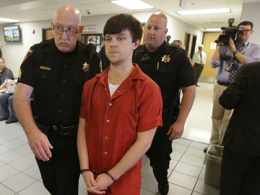 Ethan Couch is led to a juvenile court for a hearing Friday in Fort Worth, Texas.