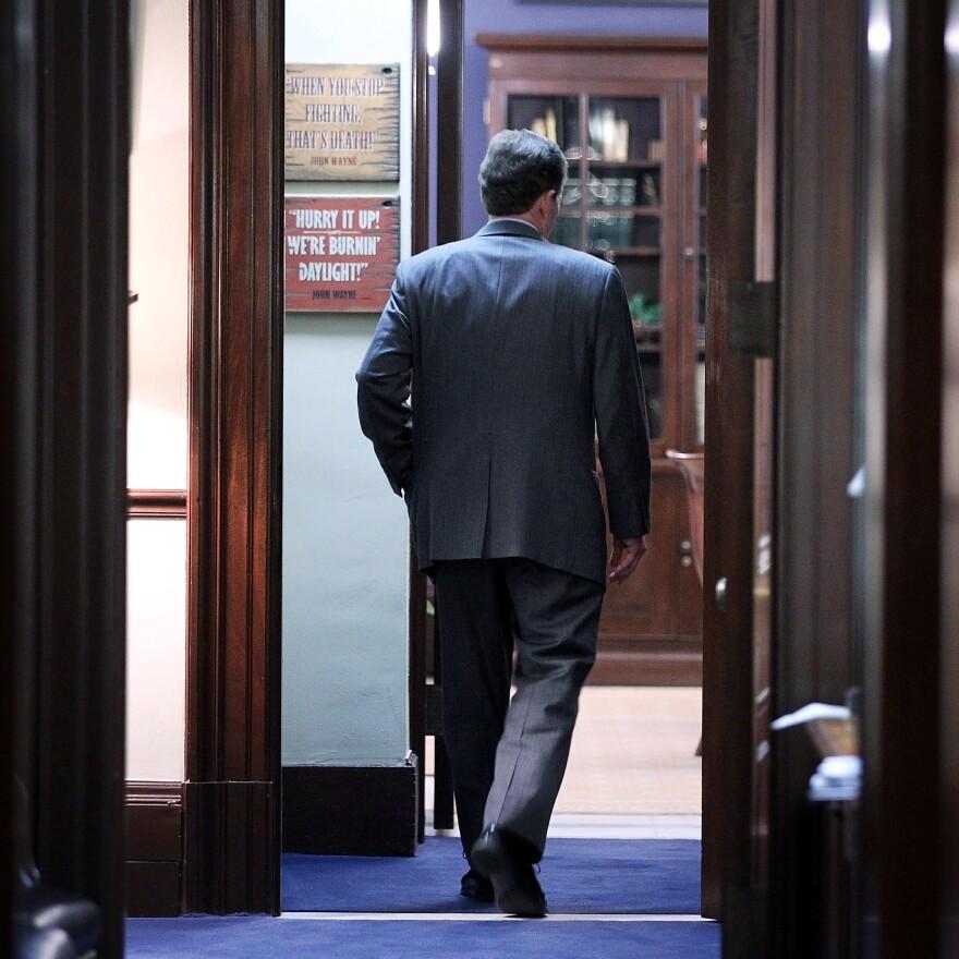 Sen. Jim DeMint, R-S.C., enters his Capitol Hill office on Dec. 6.