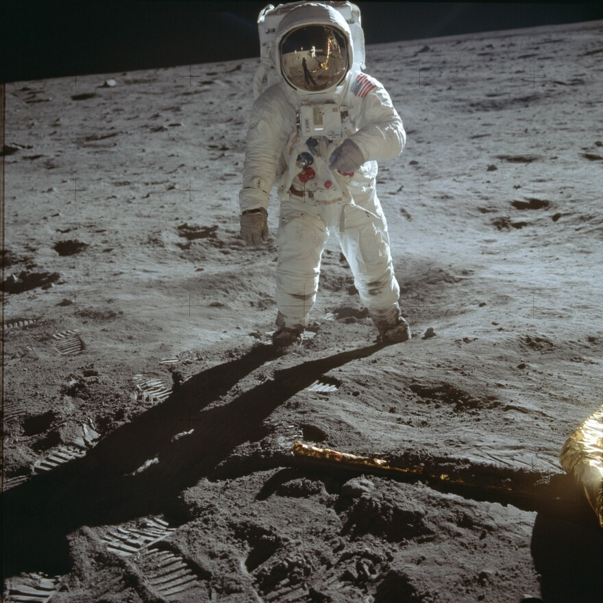 Astronaut Buzz Aldrin, lunar module pilot, walks on the surface of the moon during the Apollo 11 extravehicular activity.