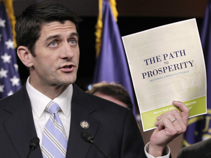 House Budget Committee Chairman Paul Ryan (R-WI) presents his 2012 federal budget during a news conference on Capitol Hill on Tuesday.