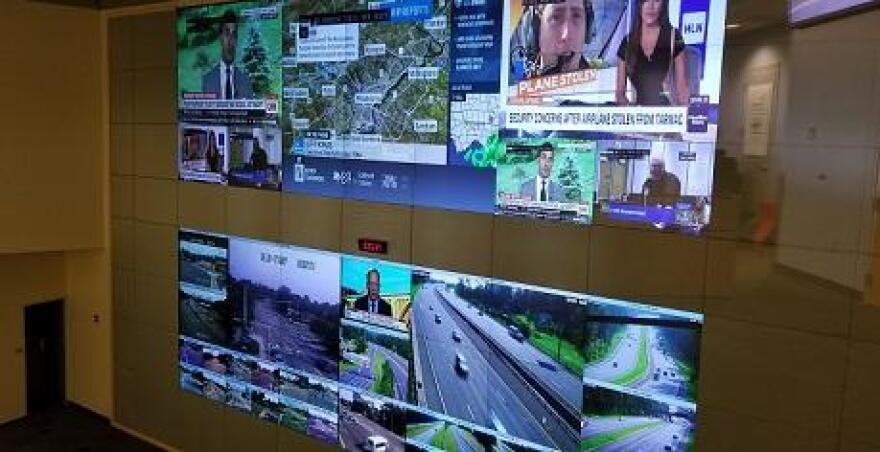 This giant wall at the public safety complex shows traffic cameras and weather reports.