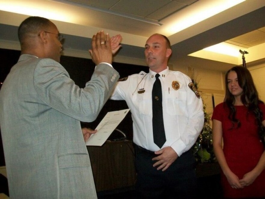 Portsmouth, Ohio, Police Chief Robert Ware (center).