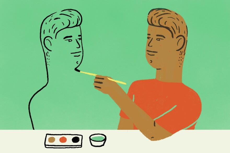 A boy paints a self-portrait