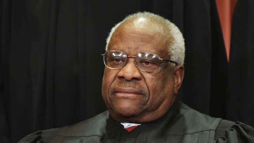 Justice Clarence Thomas poses for the official group photo at the Supreme Court last year.