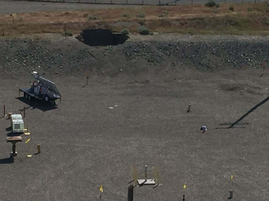 "A 20-foot-by-20-foot hole in the roof of an underground rail tunnel at the Hanford Site, a former nuclear production facility that is now contaminated, has caused some employees to be evacuated. The Department of Energy says that surveys show ""no indication of release of contamination."""