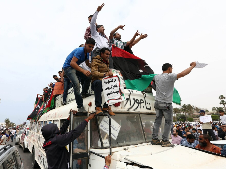 Libyan protesters stage a demonstration in the capital, Tripoli, in May. Libya's General National Congress, under pressure from armed militias, voted through a controversial law to exclude former members of Moammar Gadhafi's regime from government posts.