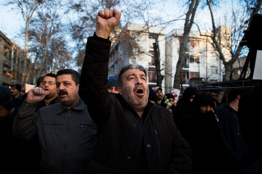 A man shouts during the funeral procession Monday in Iran's capital city.