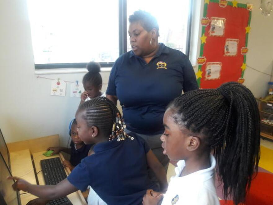 Latoya Williams gives her students instructions during computer time.