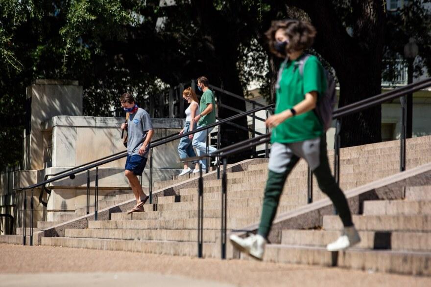 UT Austin students wear masks while walking on campus on Oct. 1.