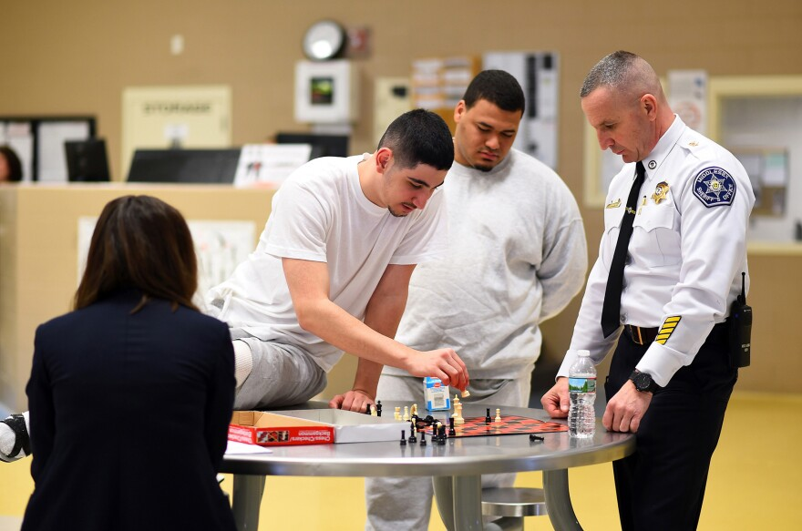 Middlesex County Correctional Facility Assistant Deputy Superintendent Scott Chaput with inmates in the prison's P.A.C.T (People Achieving Change Together) unit in Billerica, Mass.