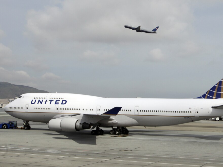 A United Airlines 747-400 taxis at San Francisco International Airport in 2011. A group of flight attendants have filed suit against the airline to contest their firing over their handling of a perceived safety threat.
