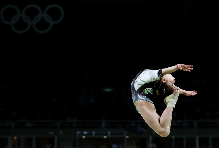 Yan Wang of China in a backbend above the balance beam on Thursday.