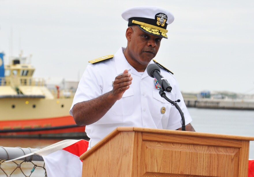 Rear Adm. Sinclair M. Harris speaks about the importance the Battle of Midway and turning point of World War II in the Pacific aboard the Arleigh Burke-class destroyer USS The Sullivans in 2013.