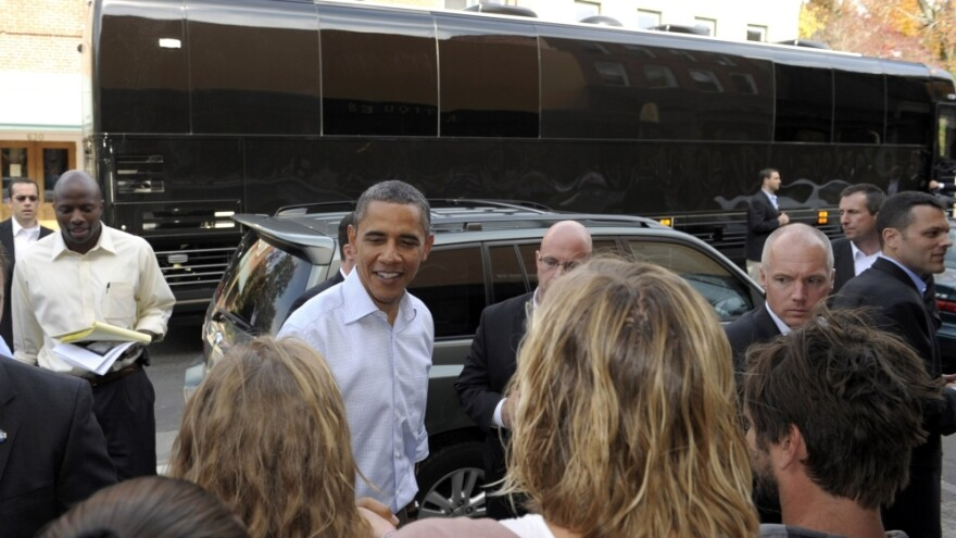 <p>With his bus in the background, President Barack Obama greets people outside of Mast General Store in Boone, N.C., Monday. Obama is on a three-day bus tour promoting the American Jobs Act. </p>