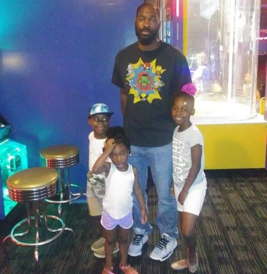 Danquirs Franklin and his three children.