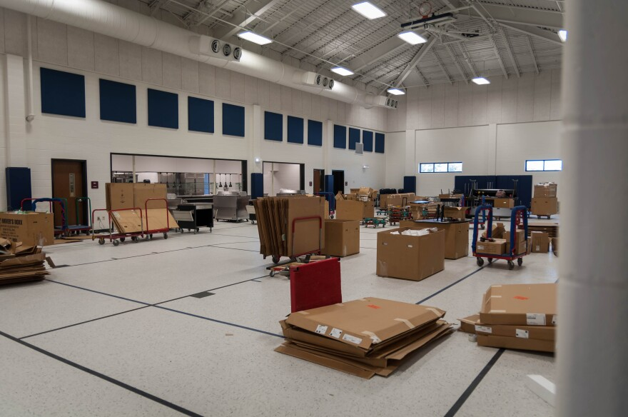 Boxes of classroom furniture sit ready to be unpacked in the gymnasium of Stone Creek Elementary, which was finished weeks before the Wentzville school year started in August. The district wants to build two more schools to keep up with growth.