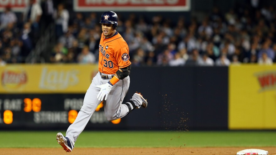Houston Astros outfielder Carlos Gomez circles the bases after hitting a solo home run in the fourth inning against New York Yankees pitcher Masahiro Tanaka, giving Houston a 2-0 lead. The Astros won the wild card game 3-0 and face the Kansas City Royals next.