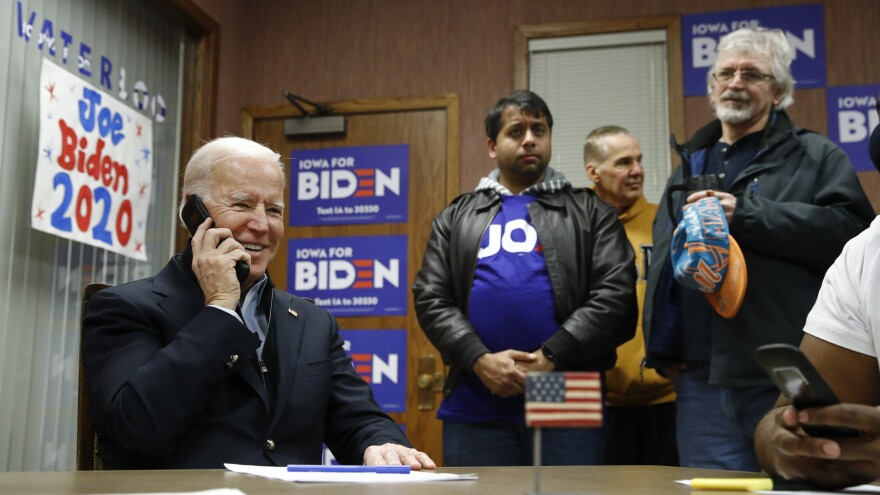 Former Vice President Joe Biden calls potential caucusgoers during a visit to a campaign field office in Waterloo, Iowa, earlier this month.