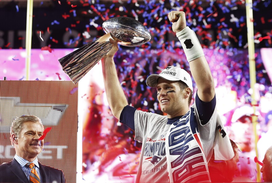 Tom Brady of the New England Patriots celebrates with the Vince Lombardi Trophy after defeating the Seattle Seahawks 28-24 to win Super Bowl XLIX at University of Phoenix Stadium on Sunday in Glendale, Arizona.