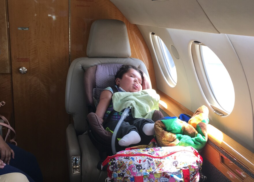 Joanlel Navarro, 3, flew from San Juan in Puerto Rico, to Ft. Lauderdale with his parents, Rosemary and Jonathan. He has Trisomy 13, and is headed to Orlando to be with his father's family and get medical treatment.