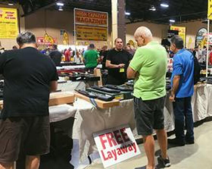 Multiple vendors offered free layaway for gun purchases at the Florida Gun Show on Saturday, Feb. 17.