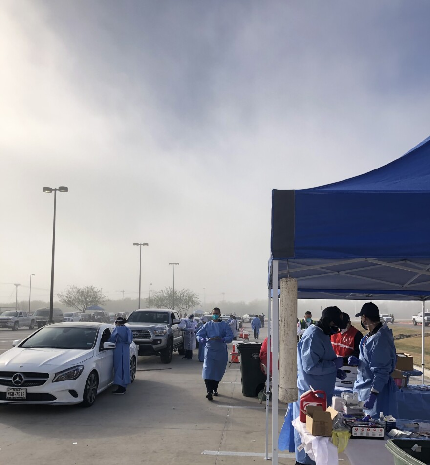 Nurses and health care workers administer COVID-19 vaccines at Laredo's drive-thru distribution event on Monday, Jan. 4, 2021.
