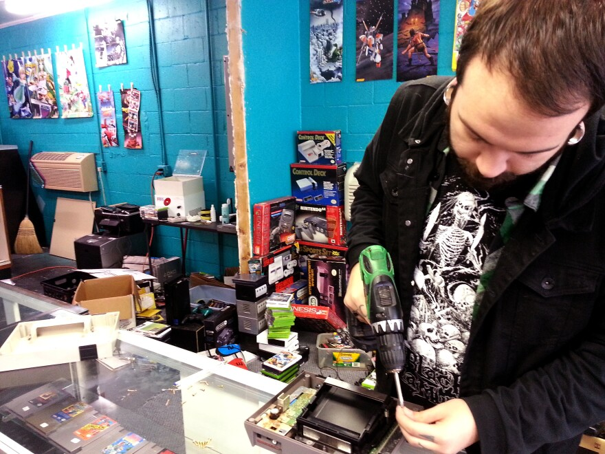 Nick Chambers repairs a Nintendo Entertainment System at his store Video Game World in Huntersville, N.C. He says many of his customers are parents wanting to buy the games they played as kids for their own kids.