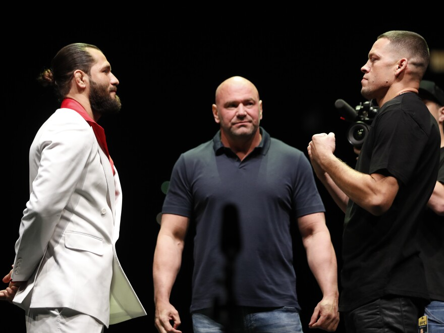 UFC President Dana White, center, at a press conference ahead of UFC 244 scheduled for Saturday in New York City. The main event is between  Jorge Masvidal, left, and Nate Diaz.