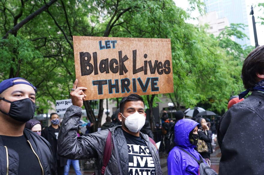 A protester holds a handmade sign in downtown Seattle on May 30.