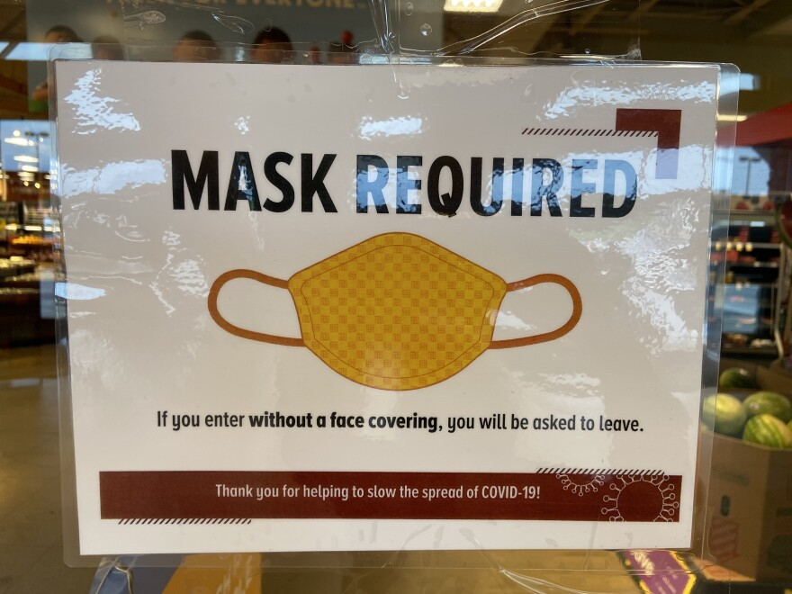 A sign on a grocery store in Columbus. Franklin County is one of 12 counties under a mask mandate issued by the state.