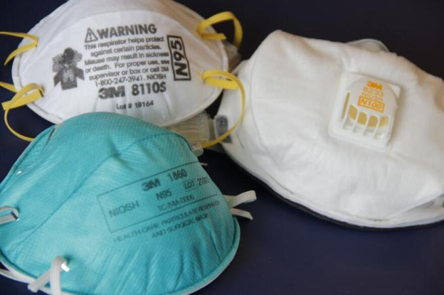 Two N95-type face masks, or respirators, and a N100-type mask.