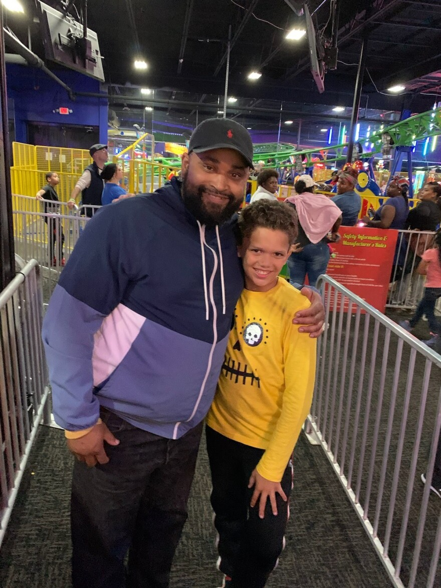 Big Brother Kittrel Braselman smiles with his Little Brother Jordan at an indoor amusement park in the region.