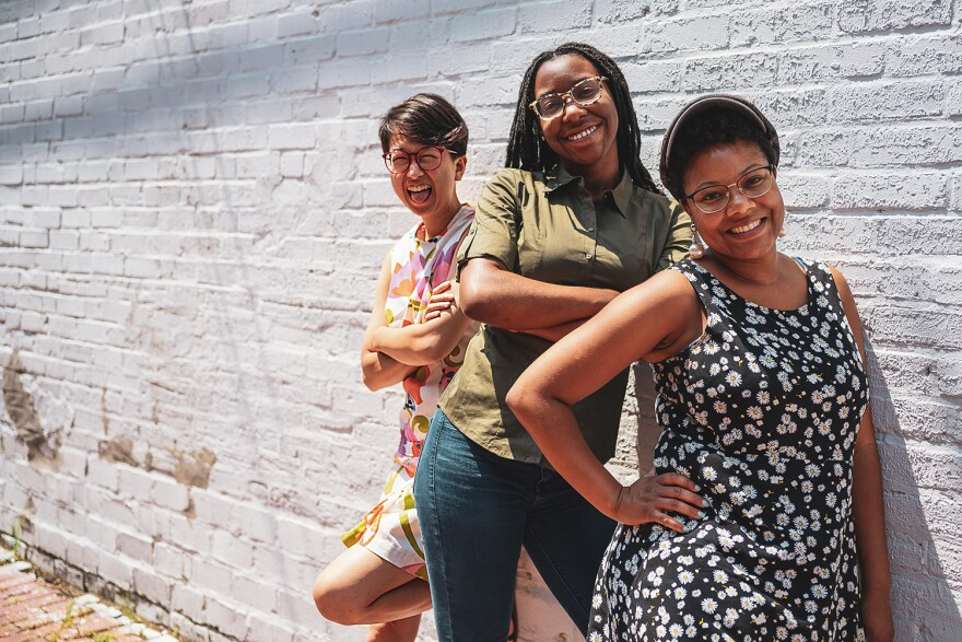 """The new """"We Live Here"""" team includes (from left) Jia Lian Yang, Lauren Brown and Ashley Winters."""