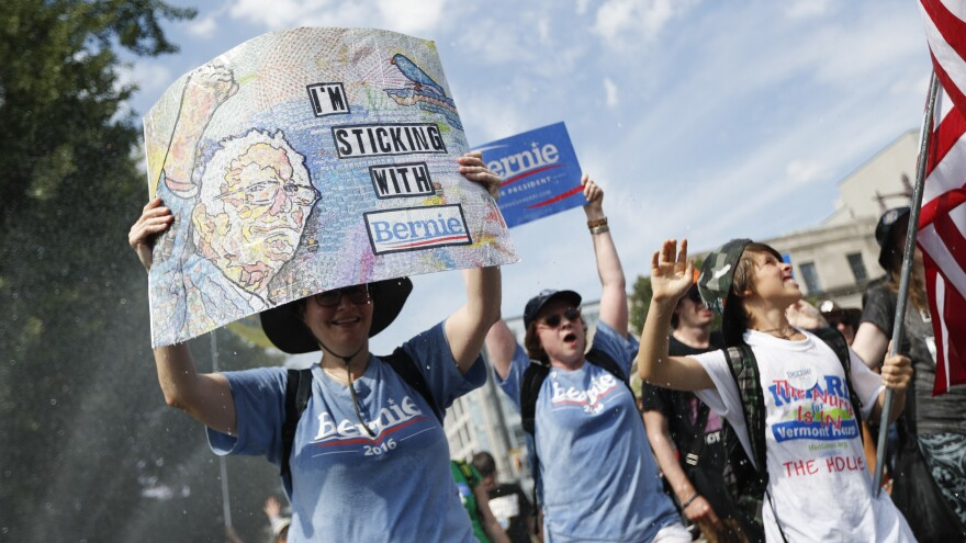 Supporters of Sen. Bernie Sanders, I-Vt., march during a protest in downtown Philadelphia on Sunday.