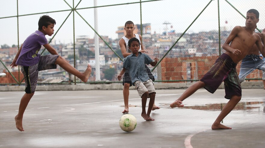 Brazilian kids play soccer in a <em>favela,</em> or shantytown, in Rio de Janeiro on Sunday. Brazil is hosting the World Cup next month and its team is considered the favorite. Many of the country's top players learned the game playing in the street or on dirt fields.