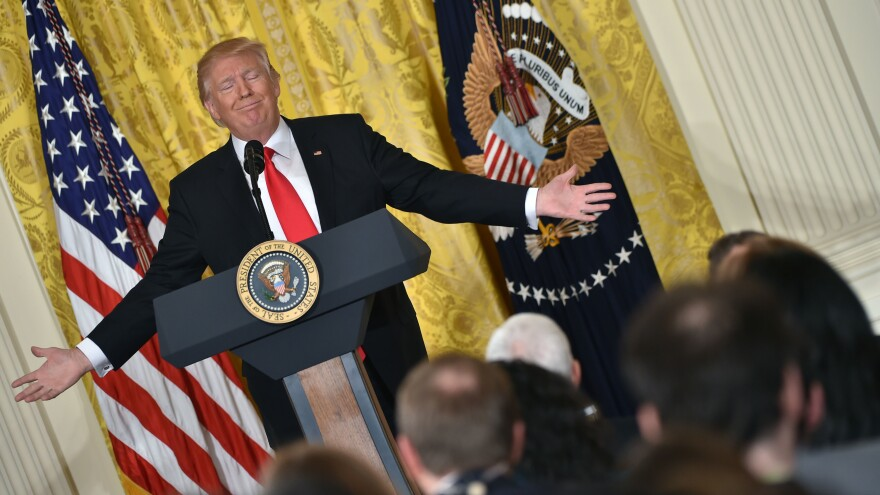President Trump speaks during a news conference at the White House on Thursday.