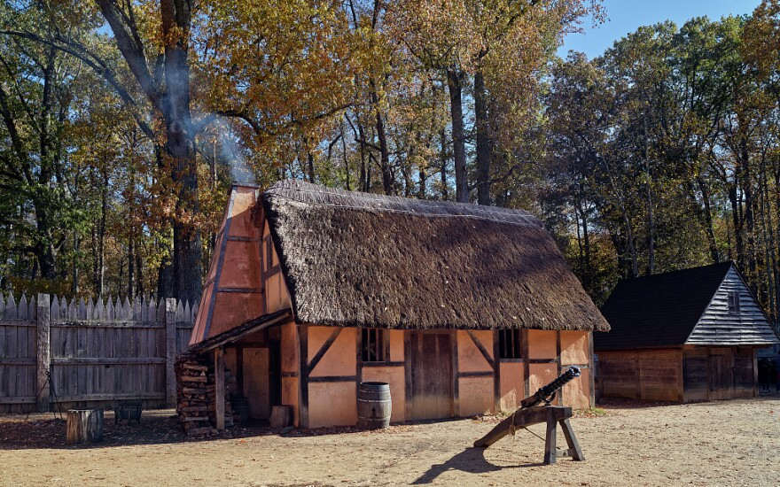 Photo showing buildings inside the reconstructed fort at the Jamestown Settlement in Jamestown, Virginia