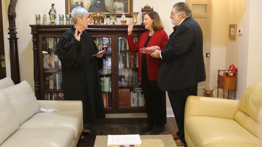 Ohio Supreme Court Chief Justice Maureen O'Connor (left) administers the oath of office to new Justice Jennifer Brunner on her family's Olive Hill Farm in Columbiana County.