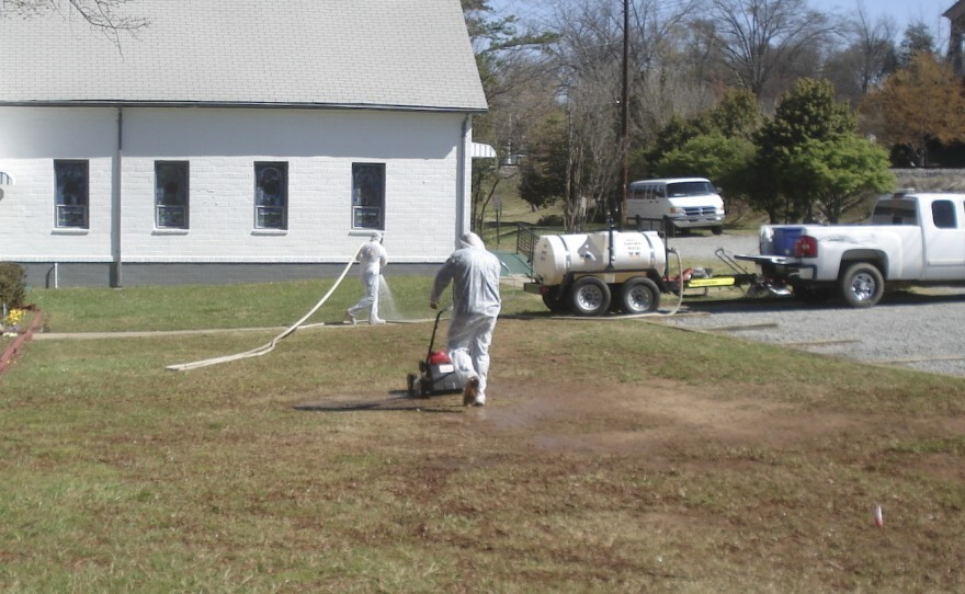 042017 Mowing at DPC in hazmat suit.jfif