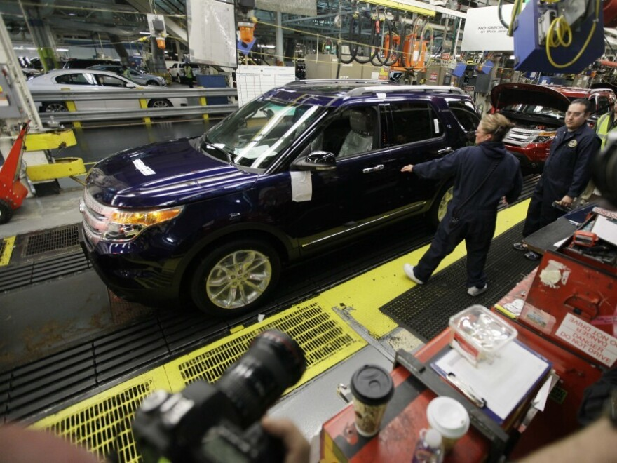 <p>Workers put together a Ford Explorer on the assembly line at the automaker's Chicago plant in 2010.</p>