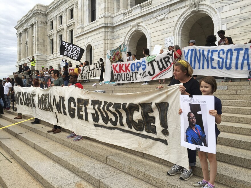 Protesters gather outside the state Capitol in St. Paul, Minn., on June 16, 2017, after St. Anthony police Officer Jeronimo Yanez was cleared in the fatal shooting of Philando Castile, a black motorist whose death captured national attention when his girlfriend streamed the grim aftermath on Facebook