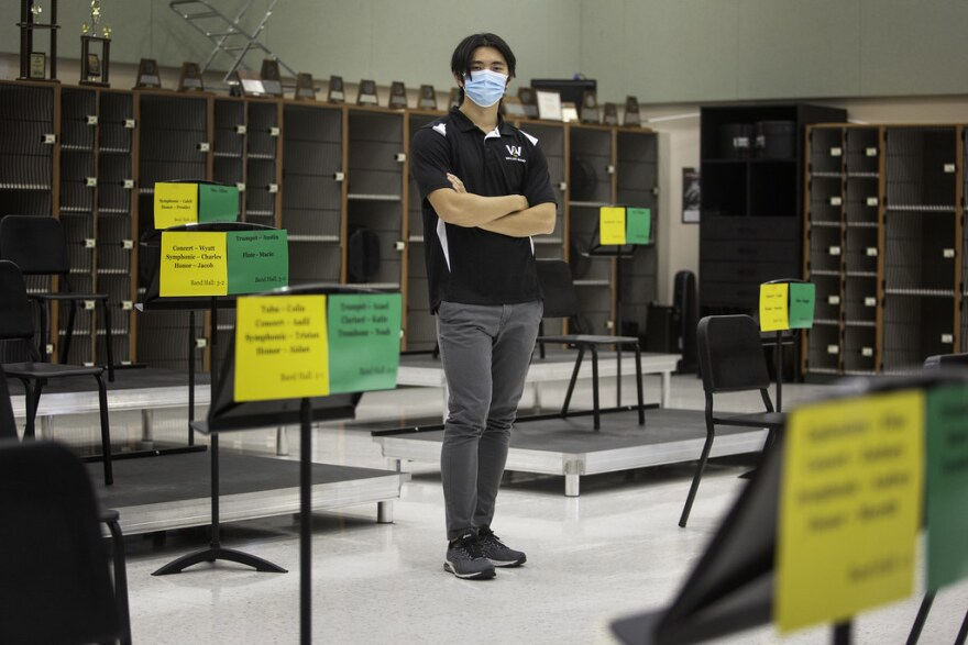 Stone Wang, an assistant band instructor, stands in his classroom at Walsh Middle School in Round Rock.